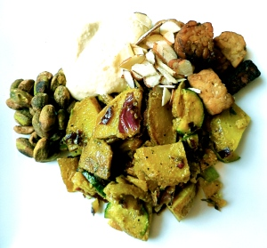 Agave Dijon potatoes and zucchini, grilled tempeh, hummus, almonds, and pistachios.